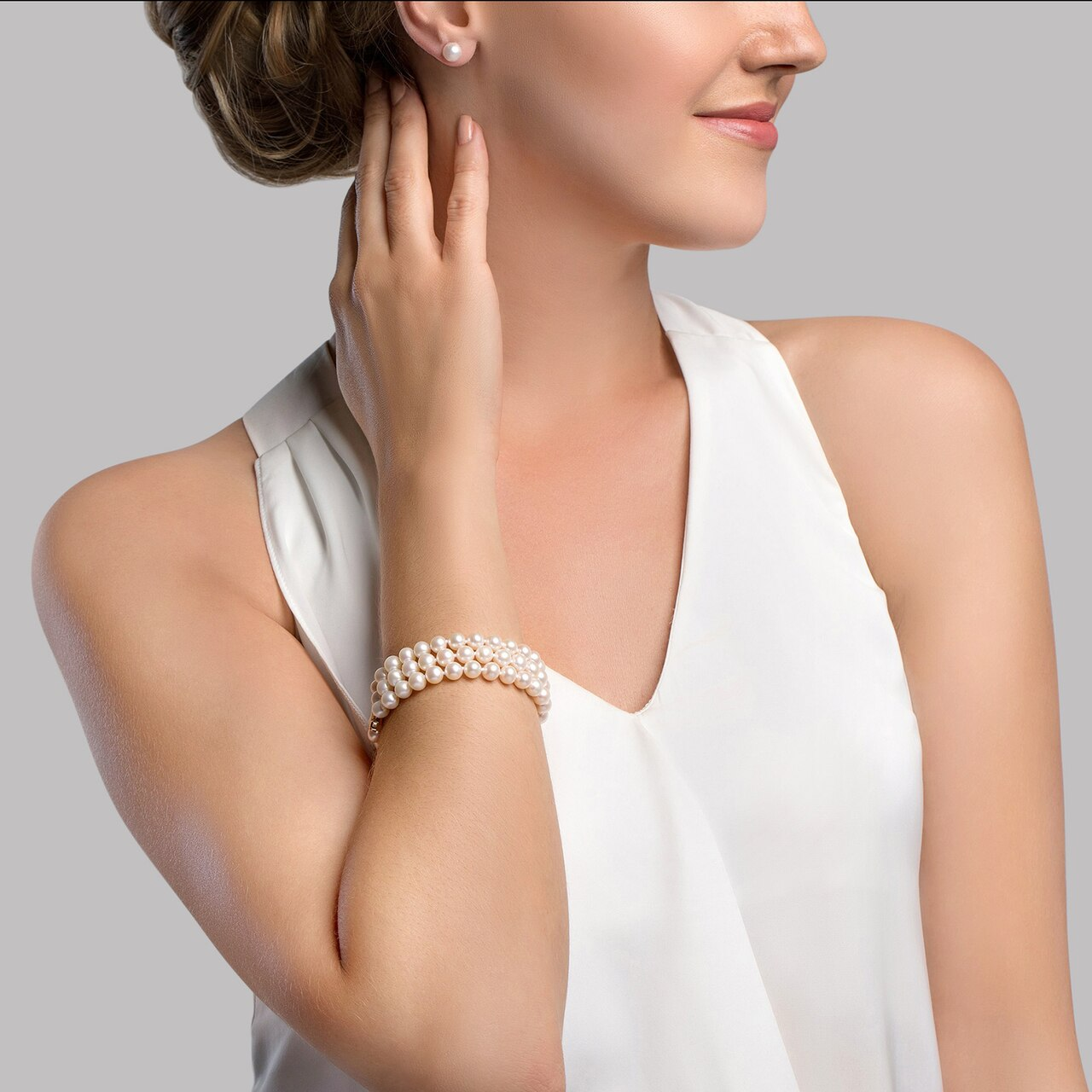 This elegant bracelet features 6.0-6.5mm triple strand Japanese Akoya pearls, handpicked for their luminous luster