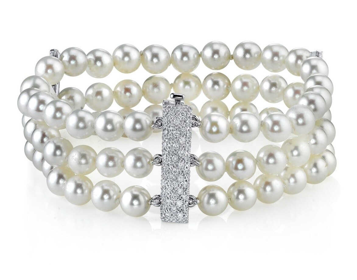 This elegant bracelet features 6.5-7.0mm Japanese Akoya pearls & diamond clasp, handpicked for their luminous luster