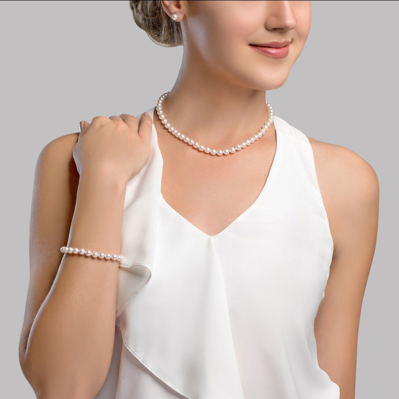 This classic necklace, bracelet and earring set features 7.5-8.0mm Japanese Akoya pearls