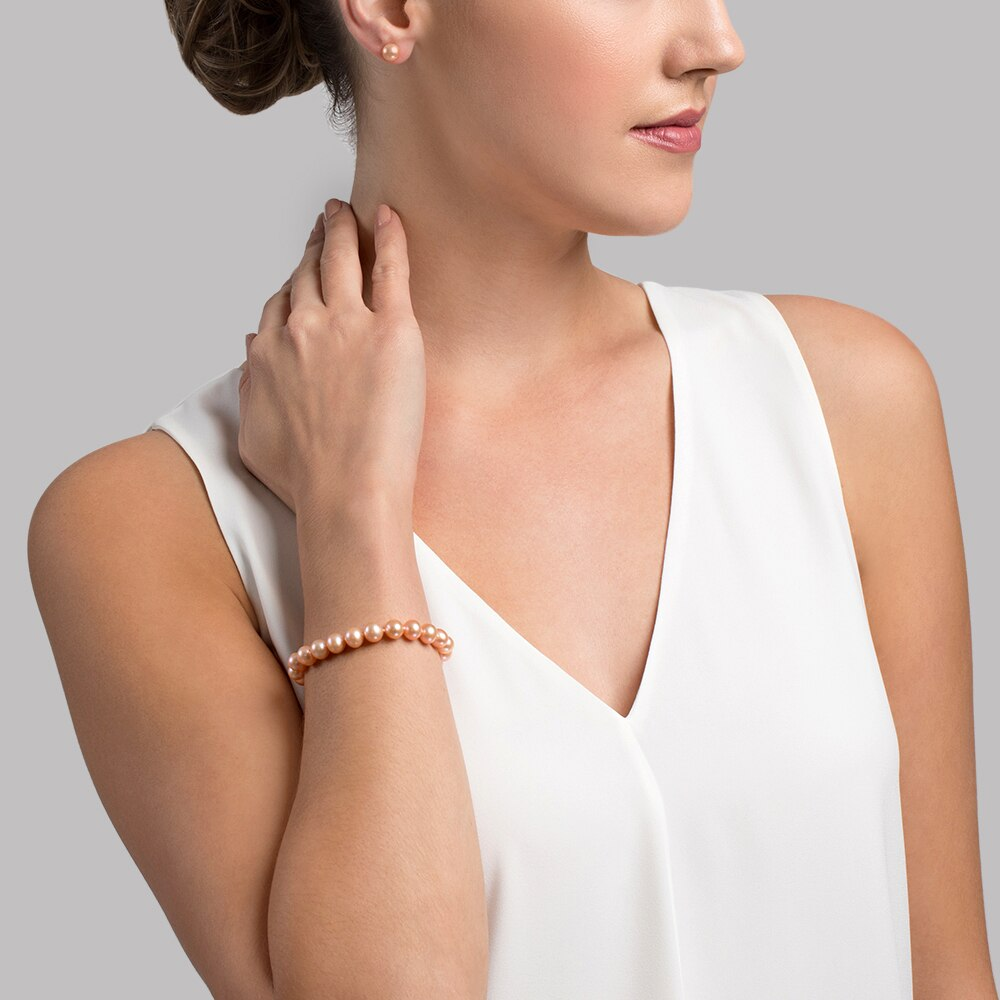 This gorgeous bracelet features 8.0-9.0mm peach Freshwater pearls, handpicked for their luminous luster