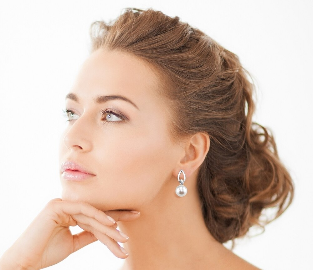 Elegant drop earrings feature two 8.0mm white Freshwater pearls, selected for their luminous luster