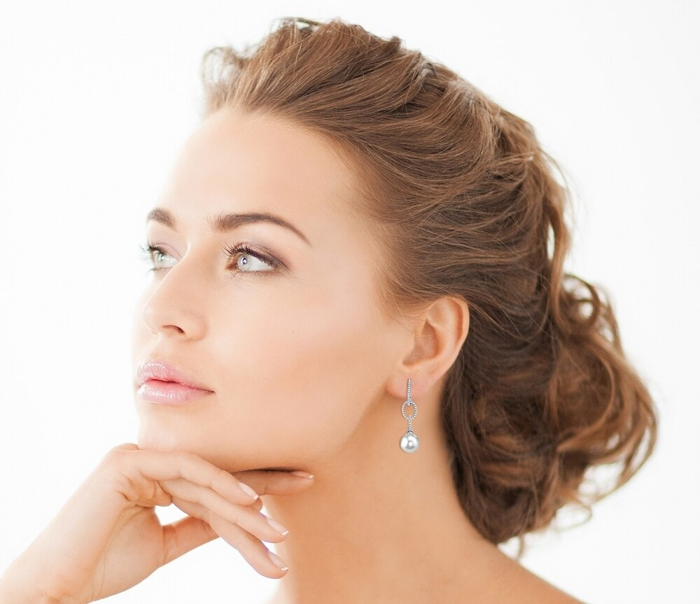 Elegant dangle earrings feature two 8.0mm white Freshwater pearls, selected for their luminous luster