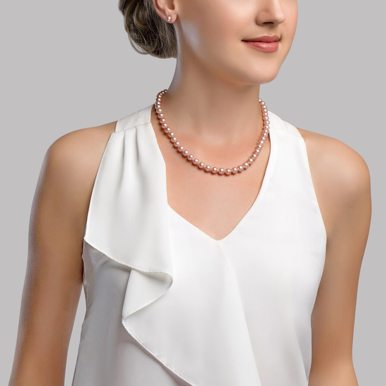 This gorgeous necklace features 8.0-9.0mm pink Freshwater pearls, handpicked for their luminous luster