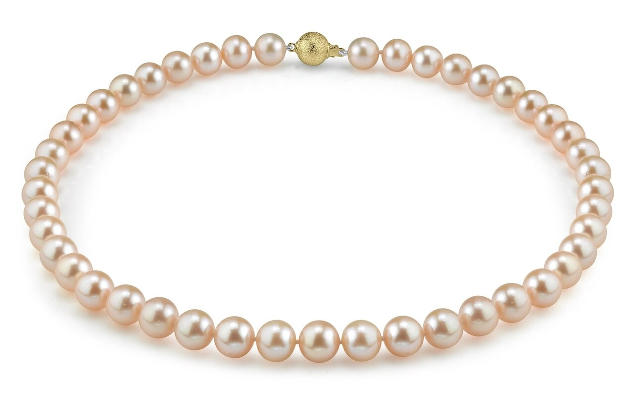 This gorgeous necklace features 9.0-10.0mm peach Freshwater pearls, handpicked for their luminous luster