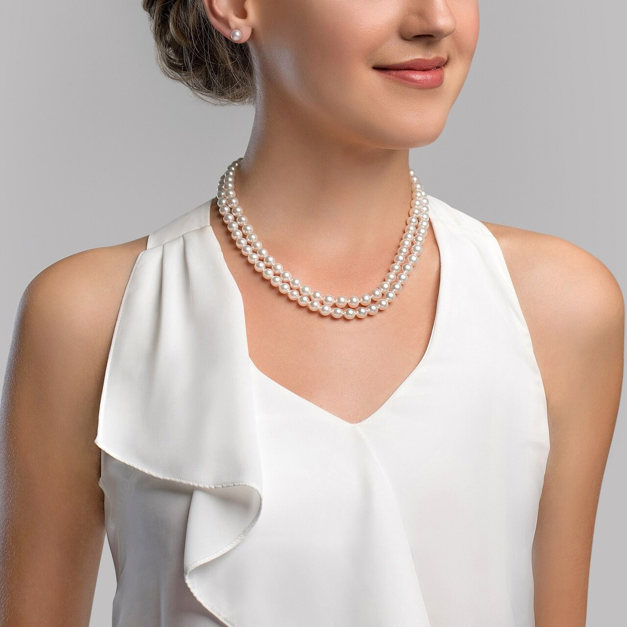 This gorgeous necklace features 9.0-10.0mm white Freshwater pearls, handpicked for their luminous luster
