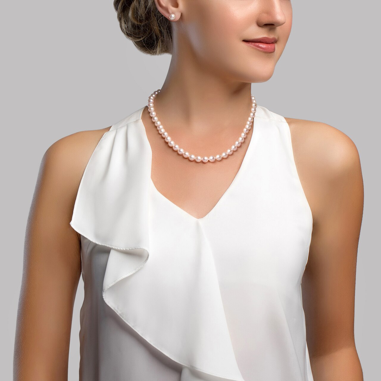 This classic necklace, bracelet and earring set features 7.0-8.0mm Freshwater pearls