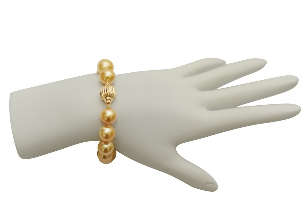 This elegant bracelet features 11.0-12.0mm Gold South Sea pearls, handpicked for their luminous luster
