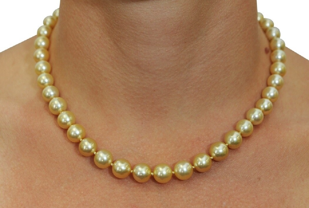 This elegant necklace features 8.0-10.0mm Gold South Sea pearls, handpicked for their luminous luster