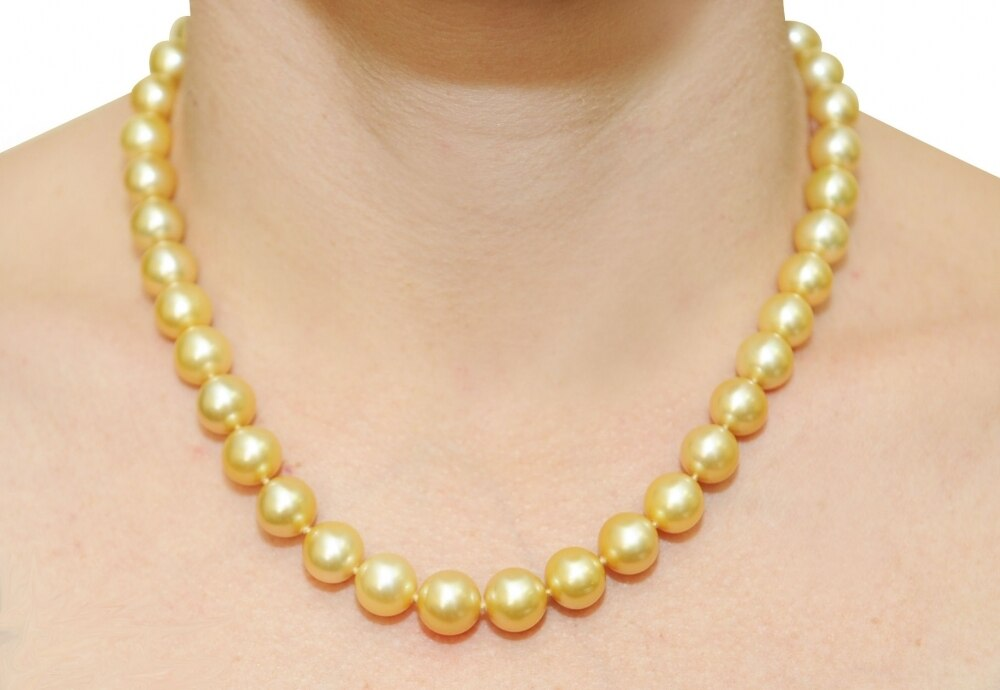 This elegant necklace features 9.0-12.0mm Gold South Sea pearls, handpicked for their luminous luster