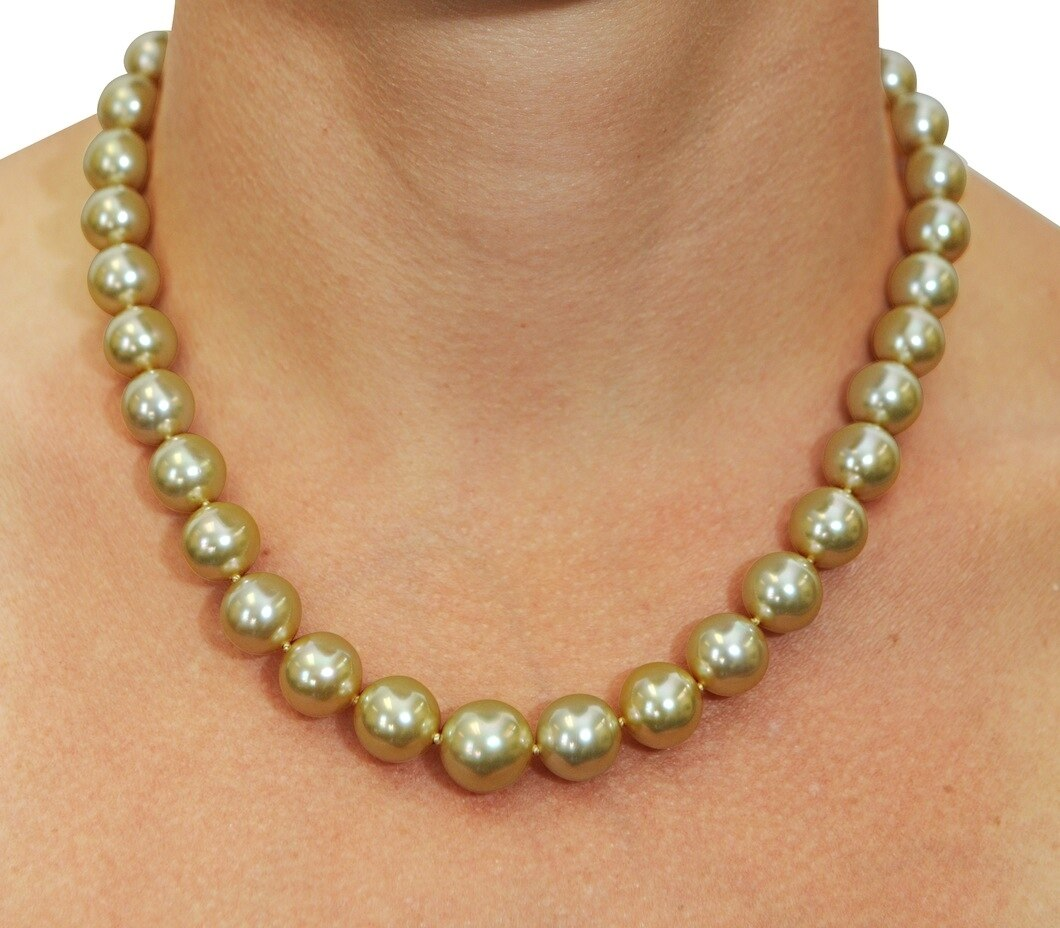 This elegant necklace features 10.0-12.0mm Gold South Sea pearls, handpicked for their luminous luster