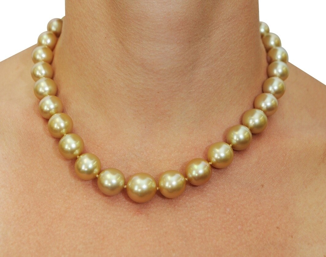 This elegant necklace features 11.0-15.0mm Gold South Sea pearls, handpicked for their luminous luster