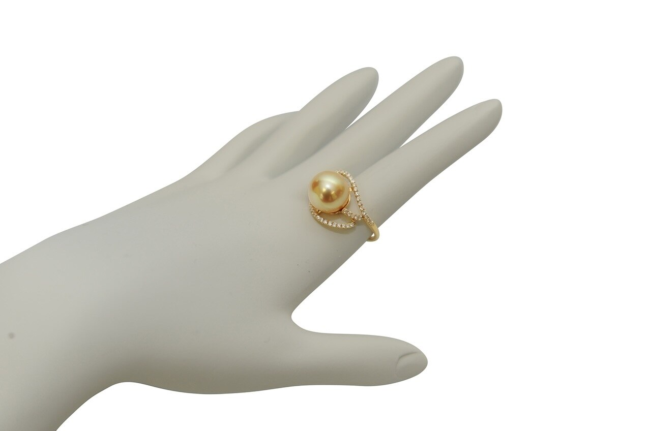 This exquisite ring features an 11.0-12.0mm Gold South Sea pearl, handpicked for its luminous luster