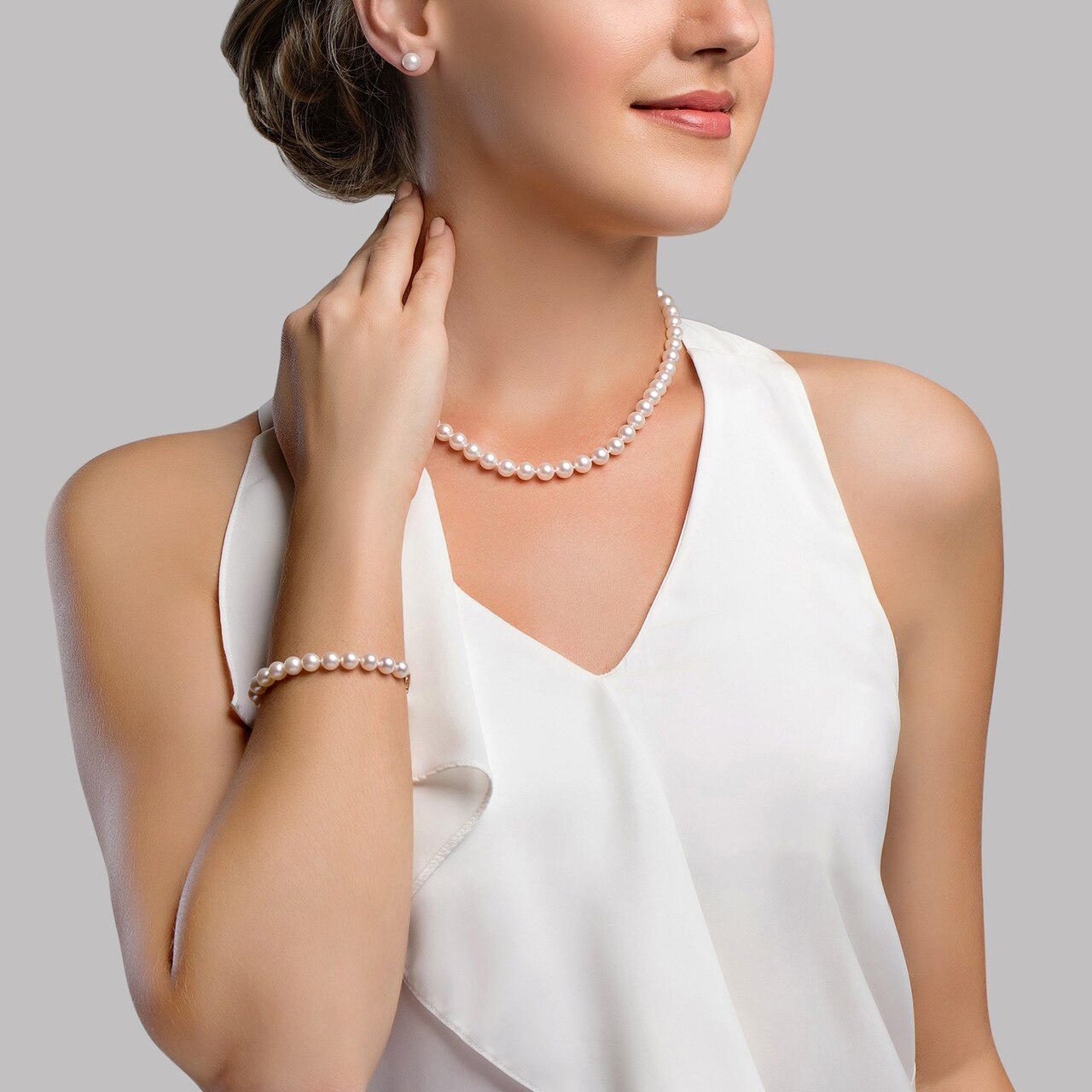 This elegant necklace, bracelet and earring set features 8.0-8.5mm Hanadama Akoya pearls
