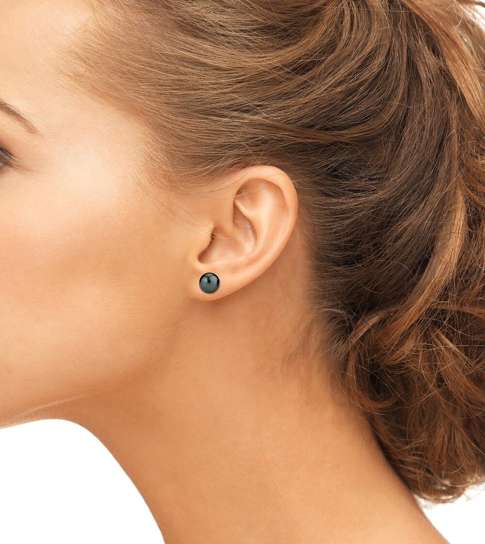 Classic stud earrings feature two 9.0-10.0mm  Tahitian South Sea pearls, selected for their luminous luster