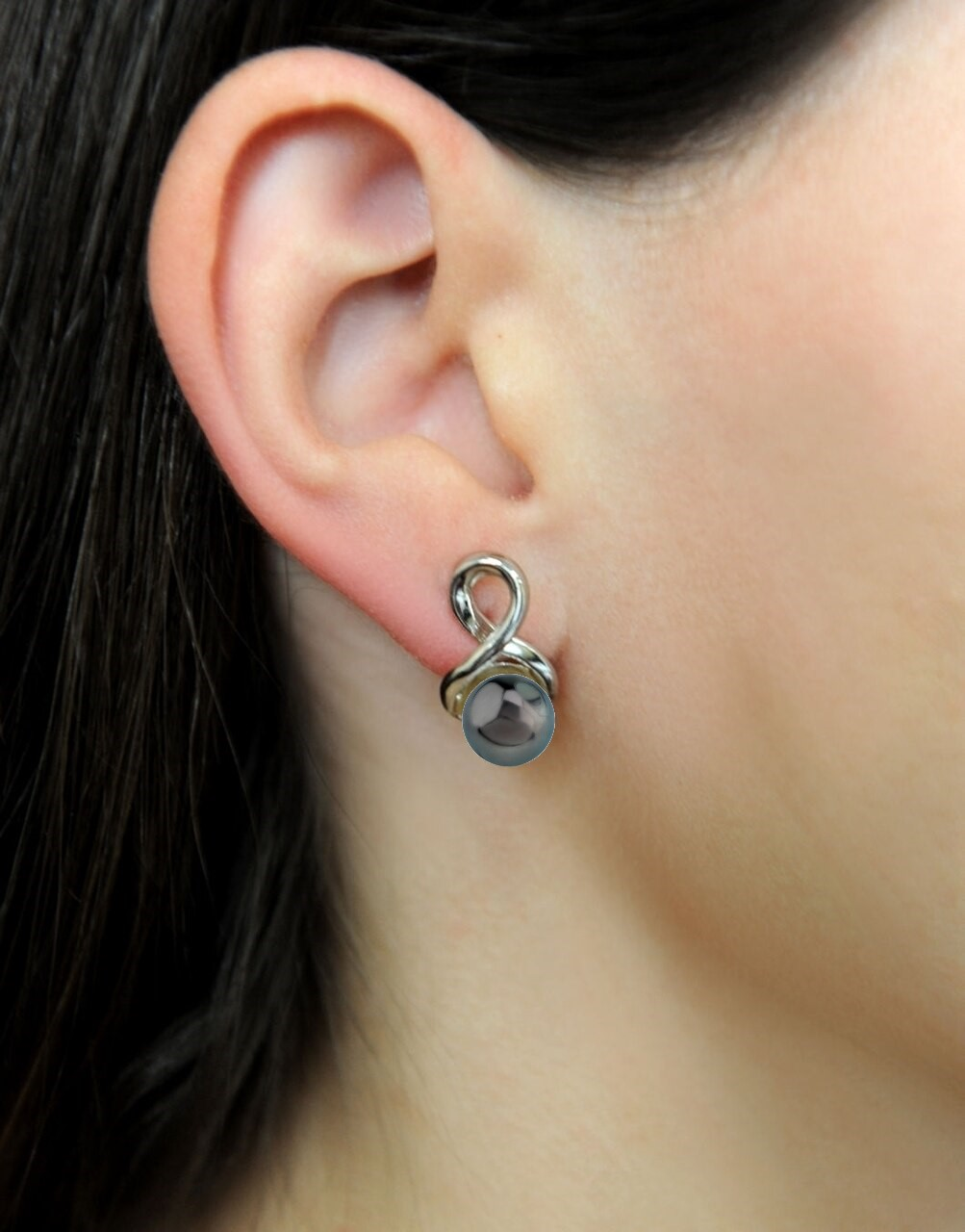Exquisite earrings feature two 8.0-9.0mm  Tahitian South Sea pearls, selected for their luminous luster