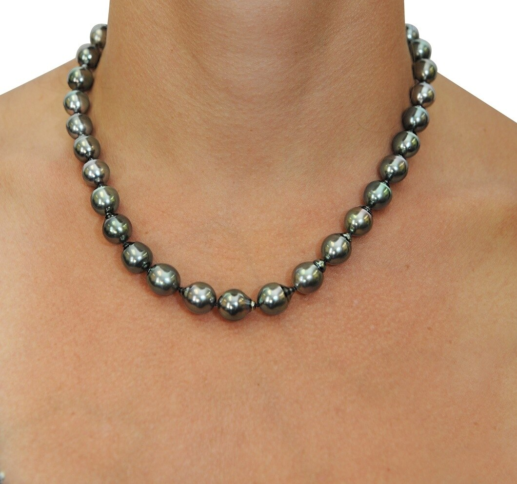 This elegant necklace features 12.0-14.0mm Tahitian South Sea pearls, handpicked for their luminous luster