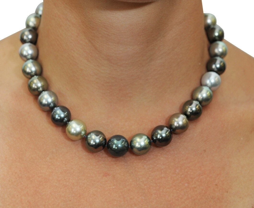 This elegant necklace features 13.0-14.0mm Tahitian South Sea pearls, handpicked for their luminous luster