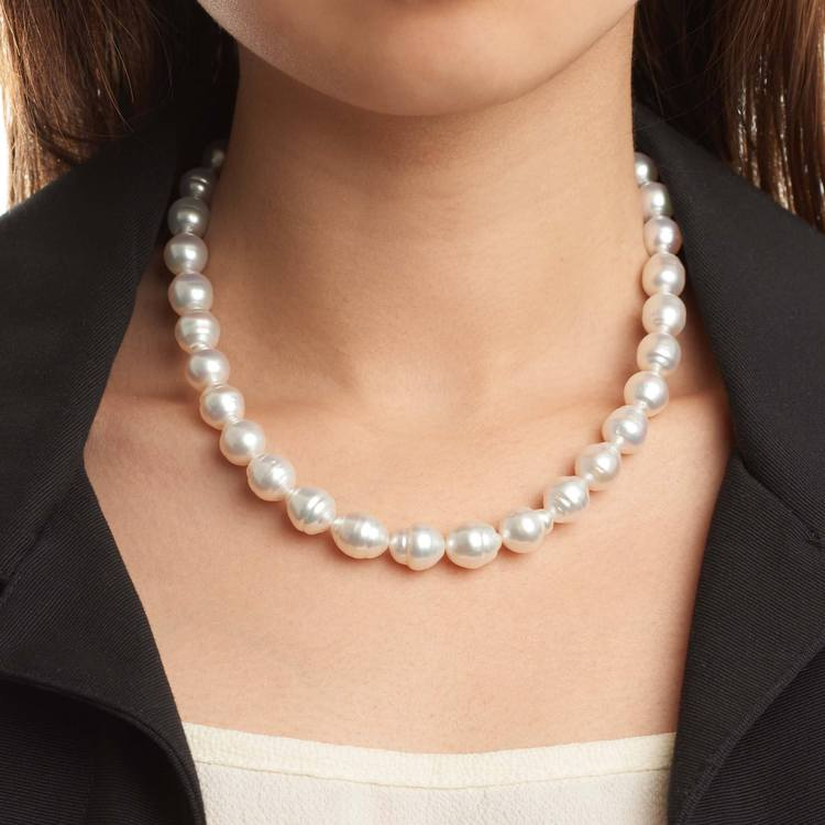 This elegant necklace features 9.0-14.0mm White South Sea pearls, handpicked for their luminous luster