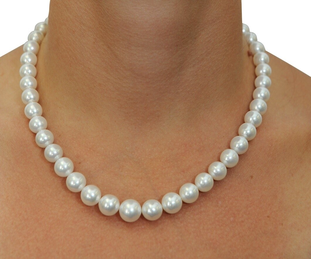 This elegant necklace features 9.0-11.0mm White South Sea pearls, handpicked for their luminous luster