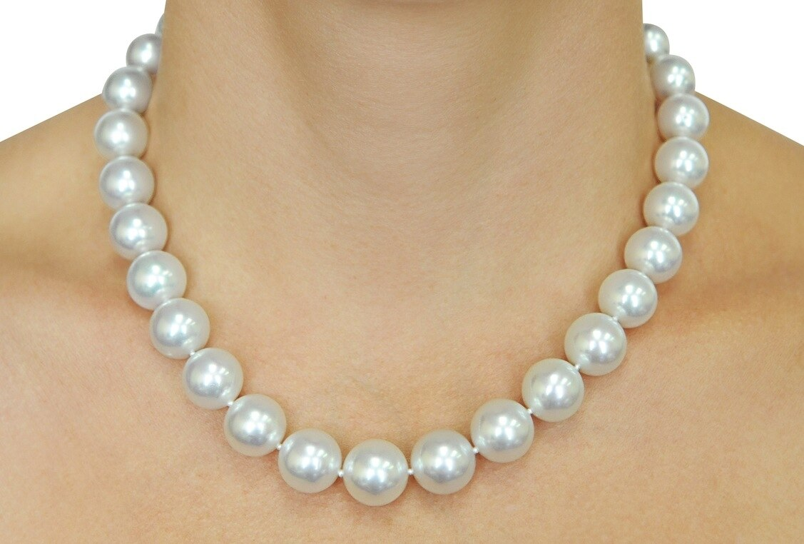 This elegant necklace features 12.0-14.0mm White South Sea pearls, handpicked for their luminous luster