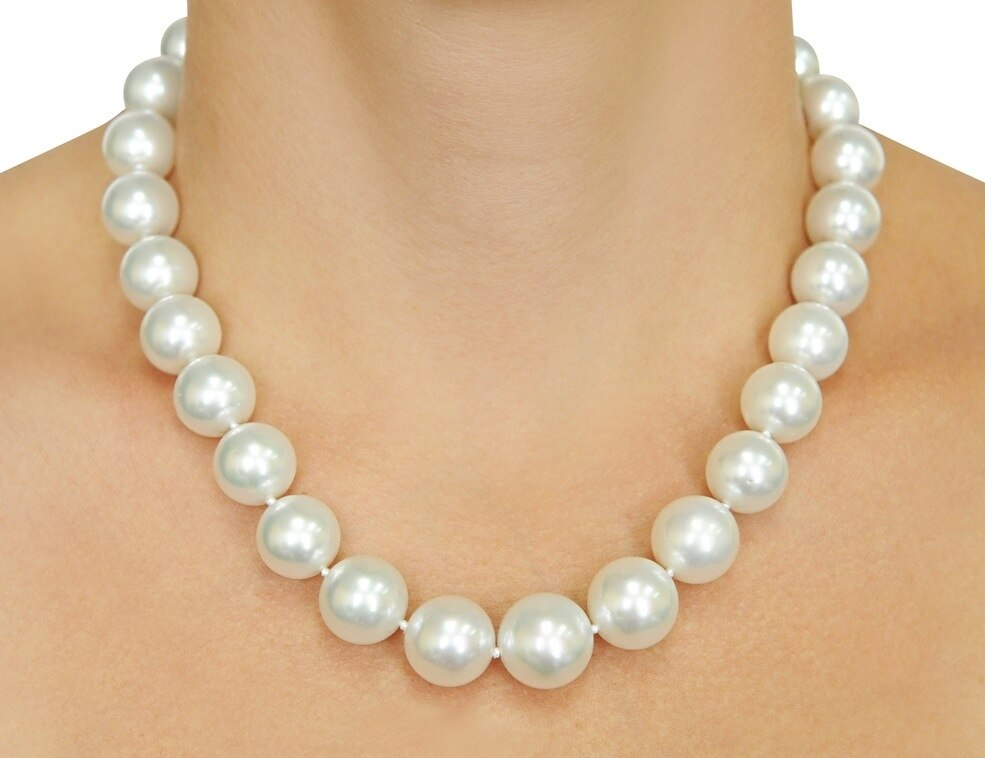 This elegant necklace features 13.0-15.0mm White South Sea pearls, handpicked for their luminous luster