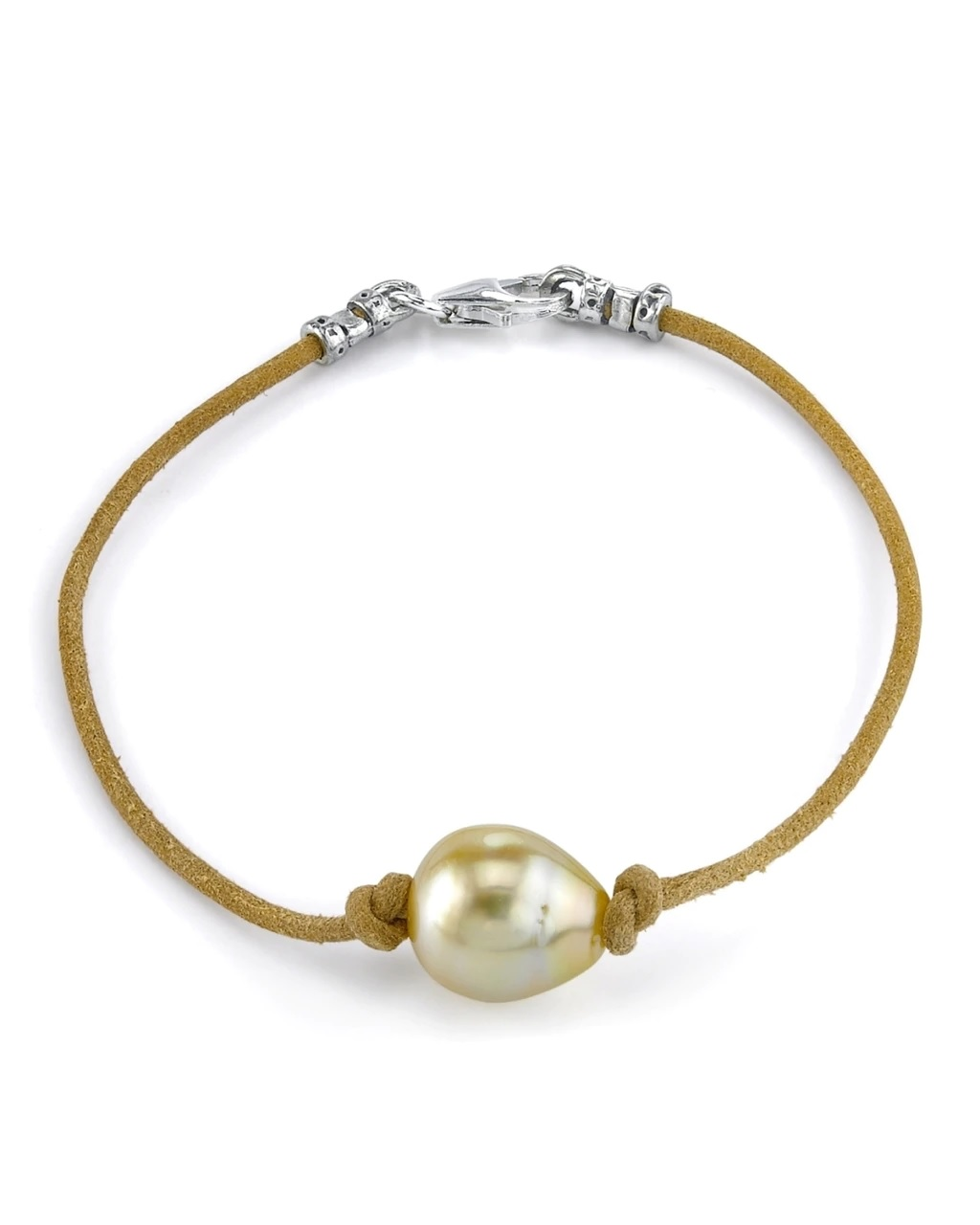 This beautiful bracelet features a baroque shaped Golden South Sea pearl